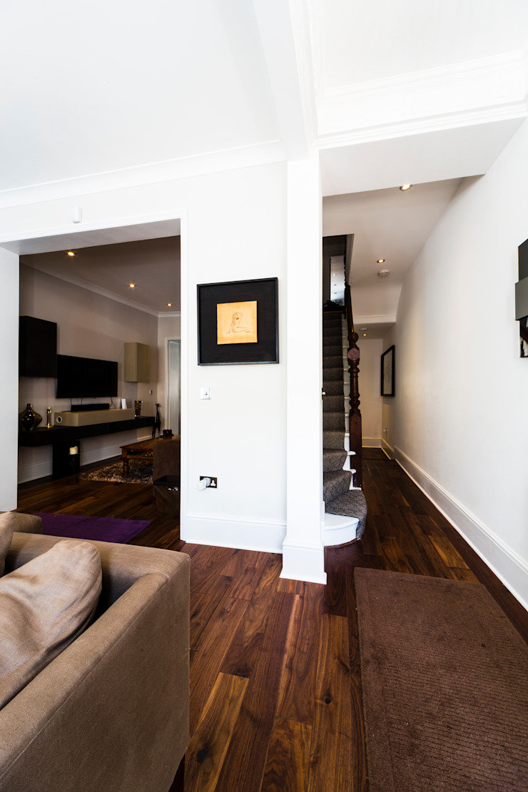 Wooden floors and white walls in the hallway Affleck Property Services Modern Corridor, Hallway and Staircase White