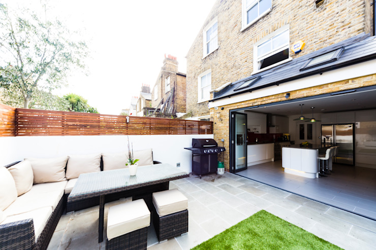 Garden, bifold doors Affleck Property Services Modern Garden White