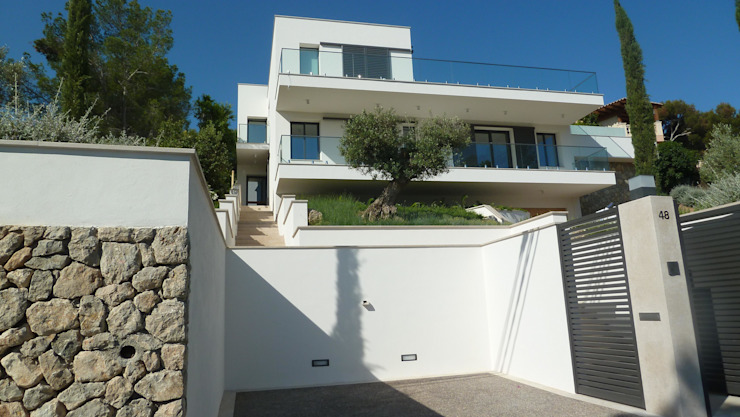 Casas de estilo  por ABAD Y COTONER, S.L., Minimalista