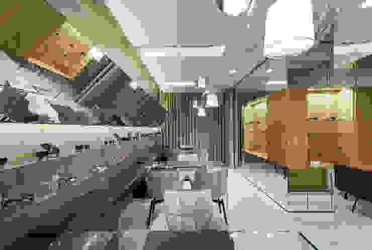 OM_9 Lojas e Espaços comerciais modernos por XYZ Arquitectos Associados Moderno