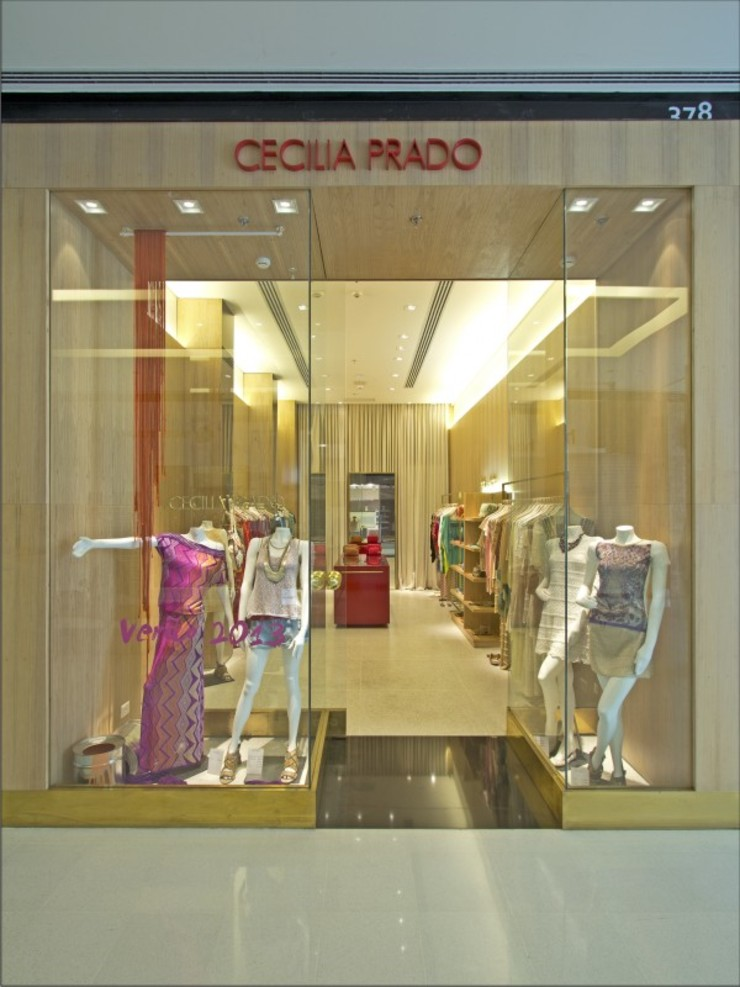 LOJA CECILIA PRADO - SHOPPING JK Lojas & Imóveis comerciais minimalistas por AMAC CONSTRUTORA Minimalista
