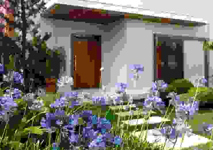 Loft Gourmet Ariane Labre Arquitetura Casas modernas Madeira maciça Branco