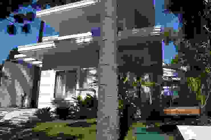 Eclectic style houses by BUZZI & SILVA ARQUITETOS ASSOCIADOS Eclectic Bricks