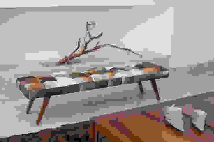 Mobiliario sobre diseño. de Dovela Interiorismo Moderno Cuero Gris