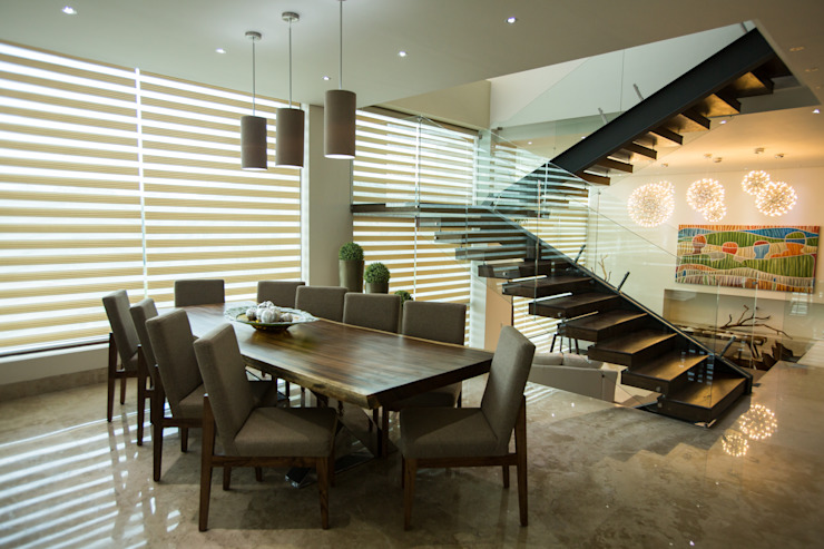 Modern dining room by Dovela Interiorismo Modern Solid Wood Multicolored
