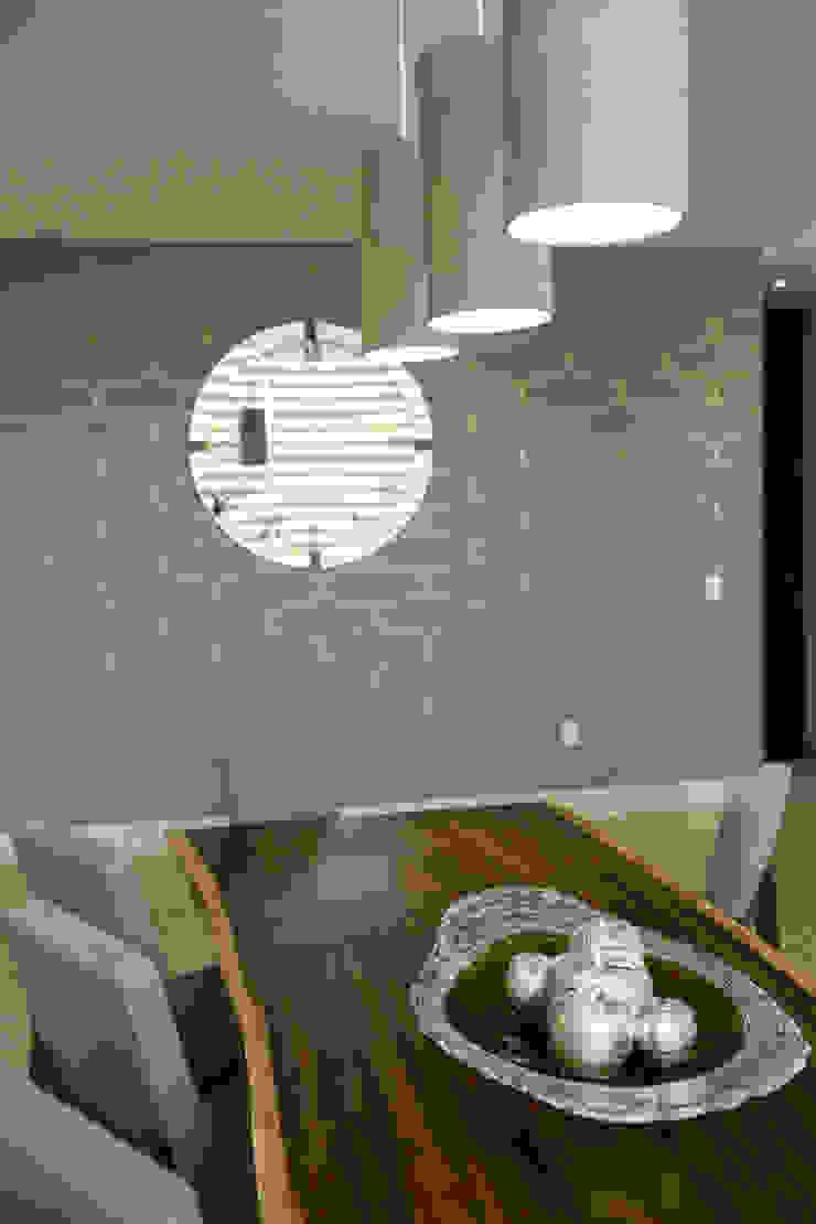 Comedor de parota. de Dovela Interiorismo Moderno Madera maciza Multicolor