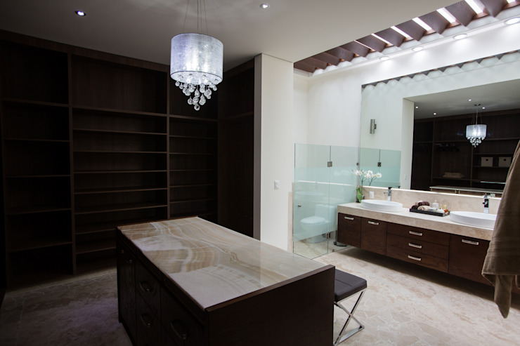 Baño y vestidor. Vestidores modernos de Dovela Interiorismo Moderno