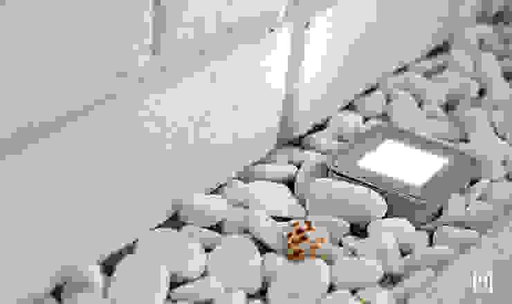 Salas de estar minimalistas por Hunter design Minimalista Pedra