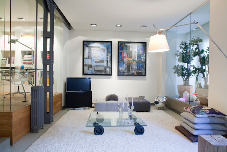 SALUD Salones de estilo moderno de MILLENIUM ARCHITECTURE Moderno