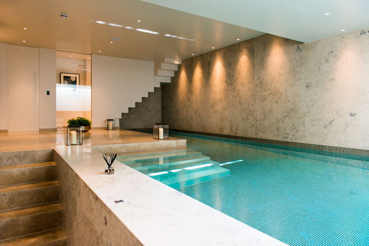 ​Basement pool at Bedford Gardens house. Modern pool by Nash Baker Architects Ltd Modern Stone