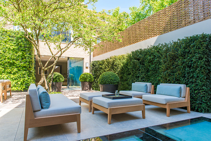 ​Back garden at Bedford Gardens House. Nash Baker Architects Ltd Modern garden