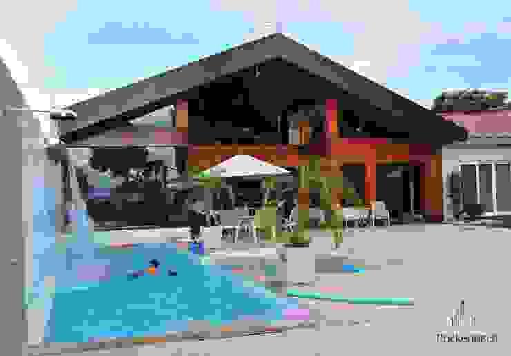 Residência Unifamiliar Entre-Ijuís -RS / Brasil Piscinas modernas por Rockenbach Arquitetos Associados Moderno