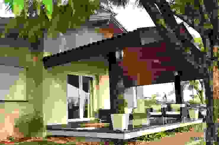 Residência Unifamiliar Entre-Ijuís -RS / Brasil Varandas, alpendres e terraços modernos por Rockenbach Arquitetos Associados Moderno