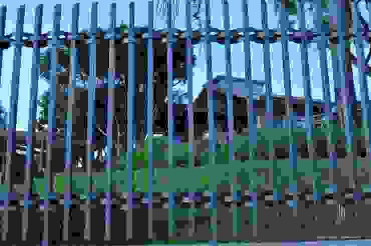 Residência Unifamiliar Entre-Ijuís -RS / Brasil Portas e janelas modernas por Rockenbach Arquitetos Associados Moderno
