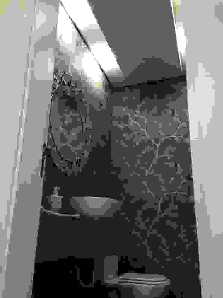 Projeto de gesso e iluminação no Lavabo Banheiros modernos por Laura Picoli Moderno
