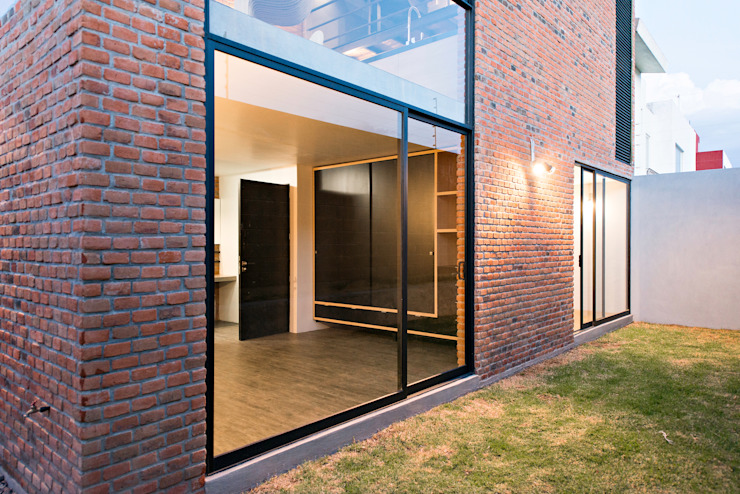 Industrial style houses by Proyecto Cafeina Industrial Glass