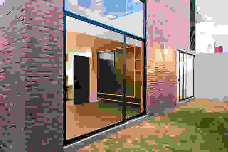 Sol 25_16 Casas industriales de Proyecto Cafeina Industrial Vidrio