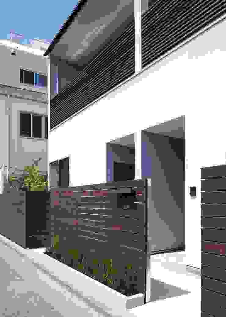 賃貸アプローチ オリジナルな 家 の Unico design一級建築士事務所 オリジナル