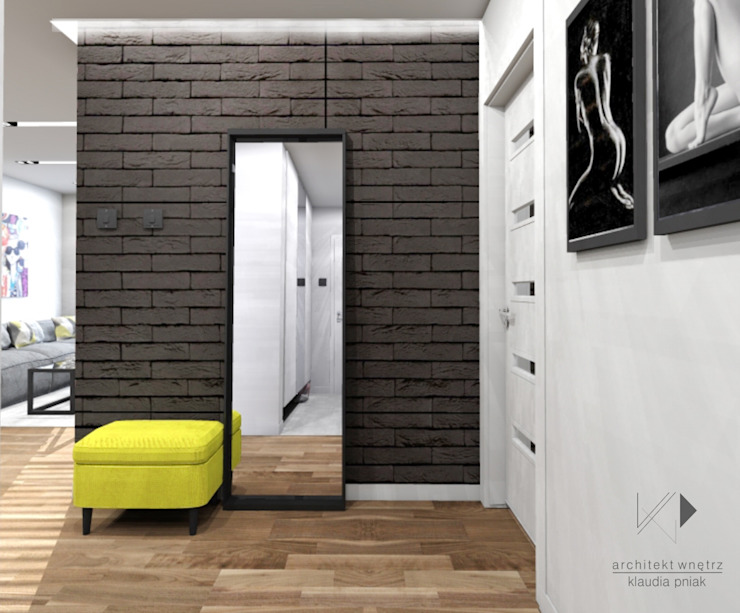 Żółty akcent,czarna cegła Nowoczesny korytarz, przedpokój i schody od Architekt wnętrz Klaudia Pniak Nowoczesny