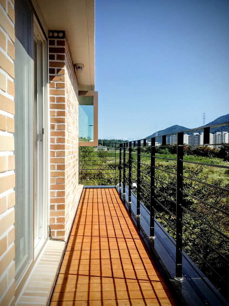 GN건축사사무소 Balcones y terrazas modernos