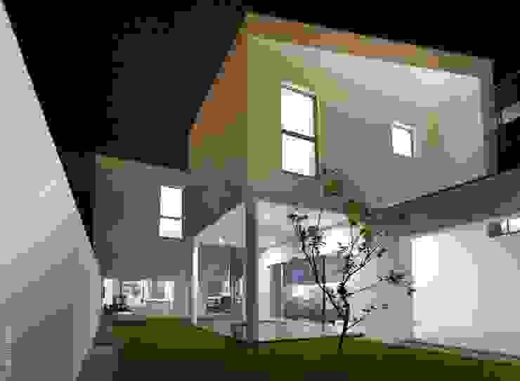 Casas de estilo  por bo | bruno oliveira, arquitectura , Moderno Granito