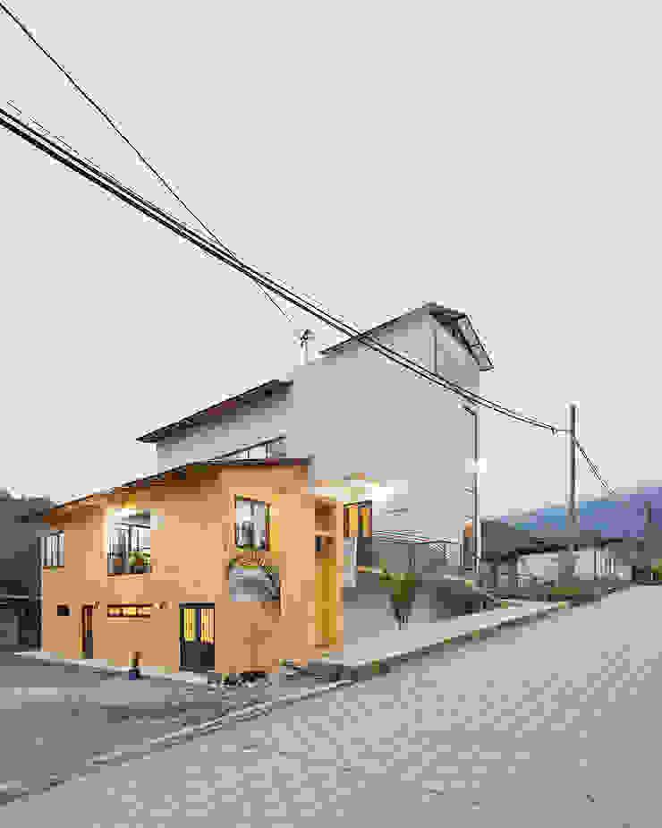Casa de la mujer indígena 2 Espacios comerciales de estilo clásico de Komoni Arquitectos Clásico Vidrio
