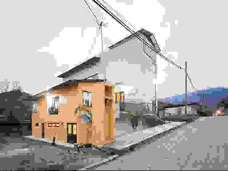 Casa de la mujer indígena 3 Espacios comerciales de estilo clásico de Komoni Arquitectos Clásico Vidrio