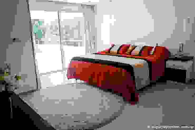 Vivienda en Grand Bell: Dormitorios de estilo  por AMADO arquitectos,Moderno