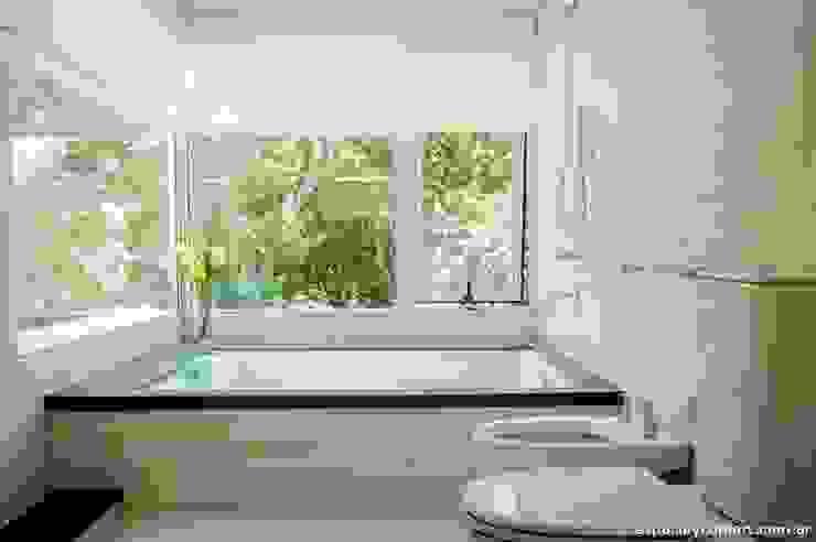 Banheiros modernos por AMADO arquitectos Moderno