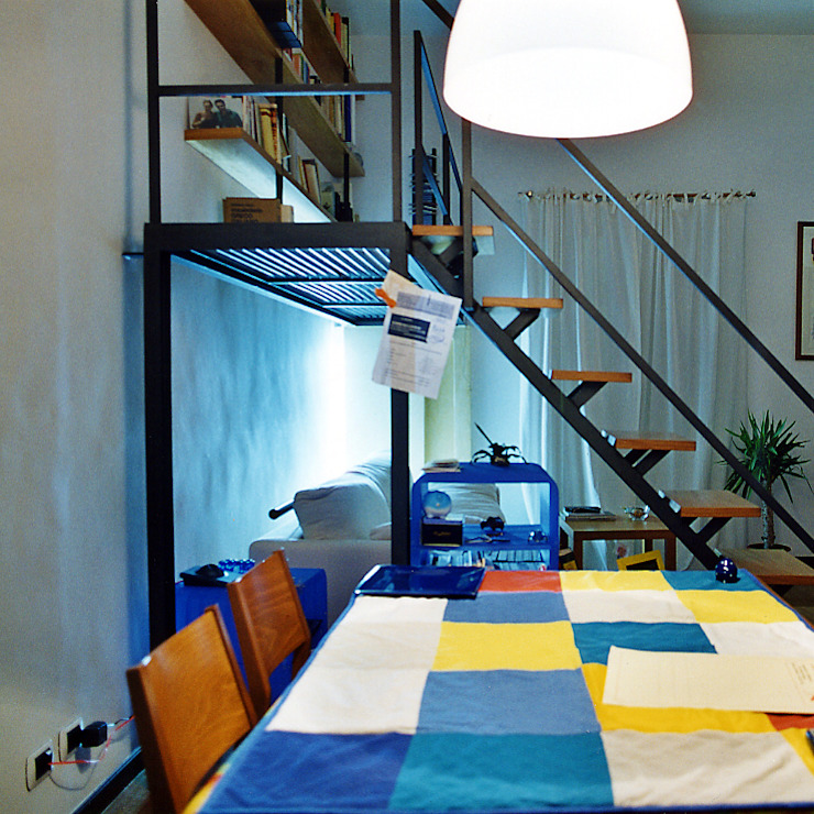 Industrial style dining room by Nicola Sacco Architetto Industrial Iron/Steel