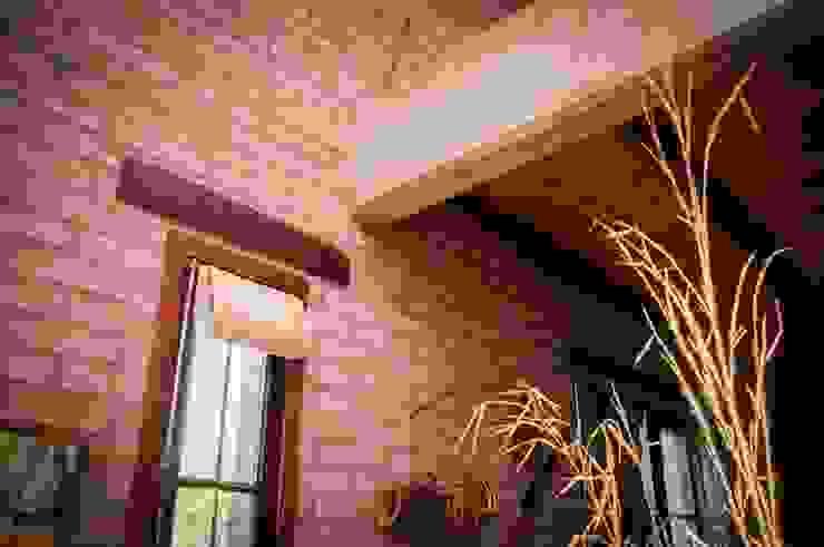 Paredes e pisos rústicos por Abitar arquitectura Rústico