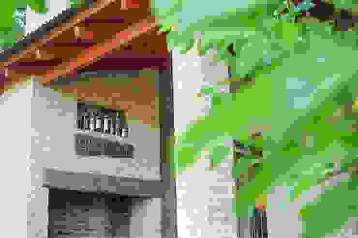 Jardins rústicos por Abitar arquitectura Rústico
