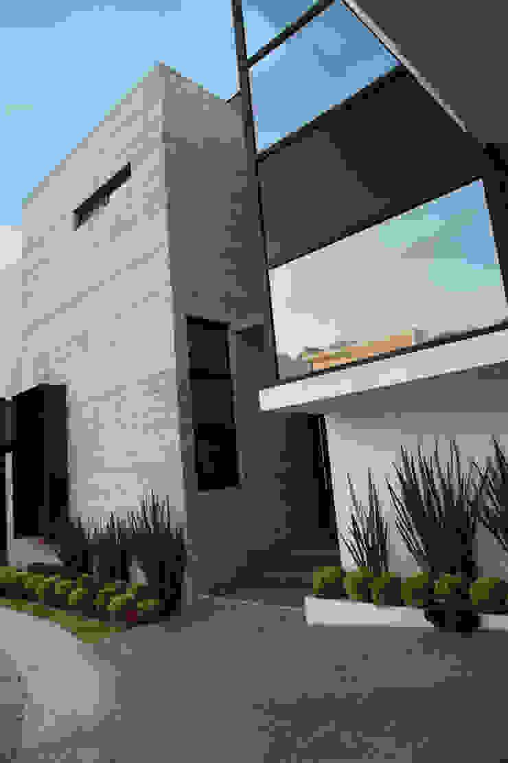 Detalle acceso / cubo de concreto Casas modernas de WRKSHP arquitectura/urbanismo Moderno Caliza