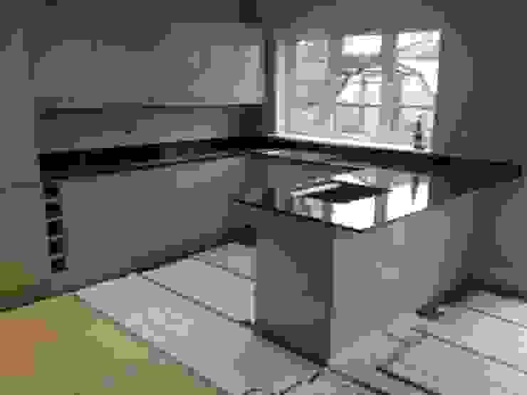 Polished Absolute Black Granite Modern kitchen by Marbles Ltd Modern