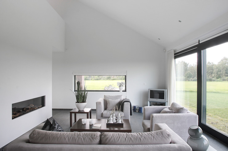 Woonkamer Moderne woonkamers van BenW architecten Modern