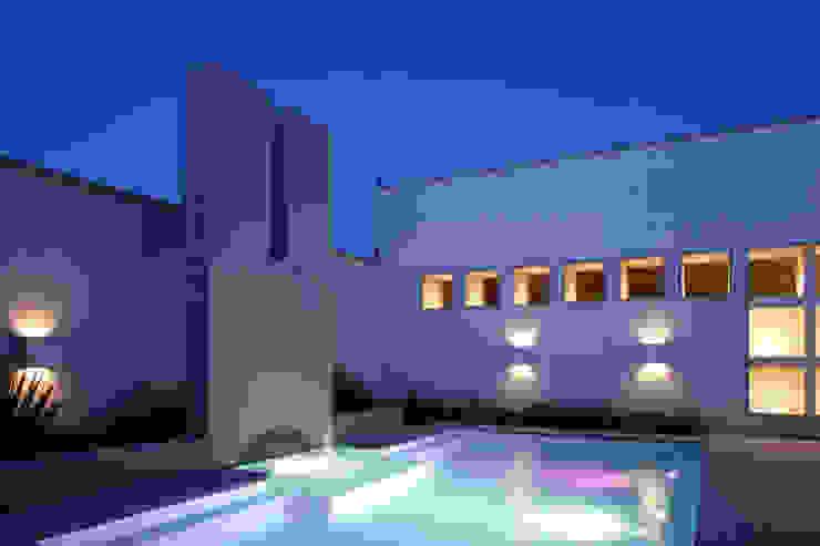 by Portico Arquitectura + Construcción Colonial