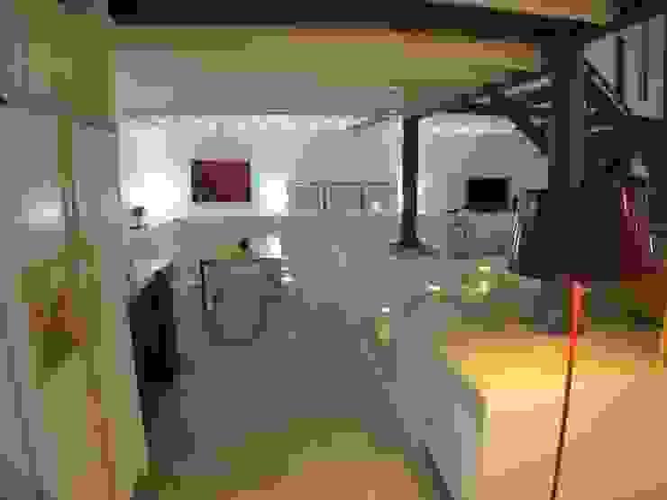 Loft Story Salas de jantar industriais por DRCF Arquitectos Industrial