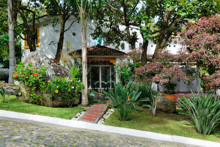 Casas coloniais por Excelencia en Diseño Colonial Tijolo