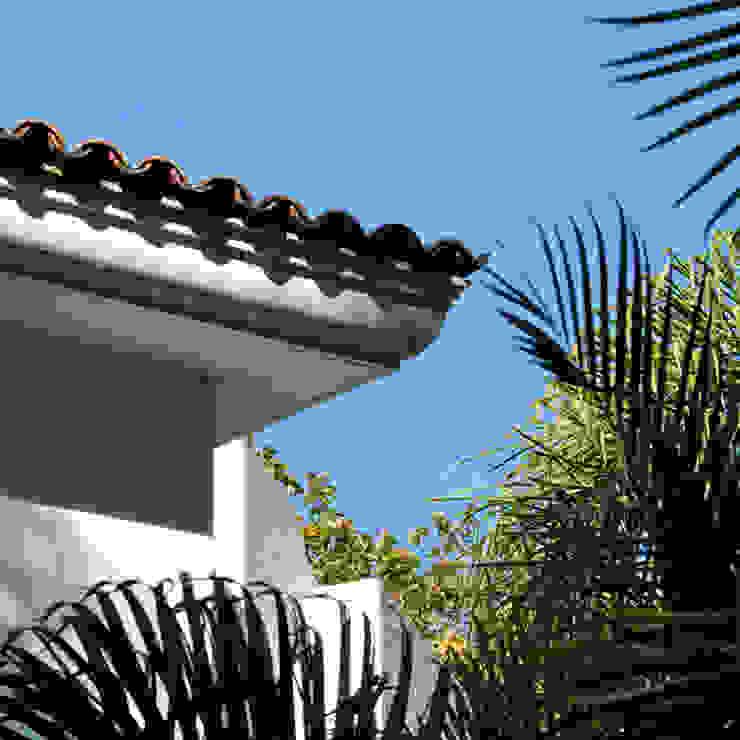 Casas de estilo  por Excelencia en Diseño , Colonial Ladrillos