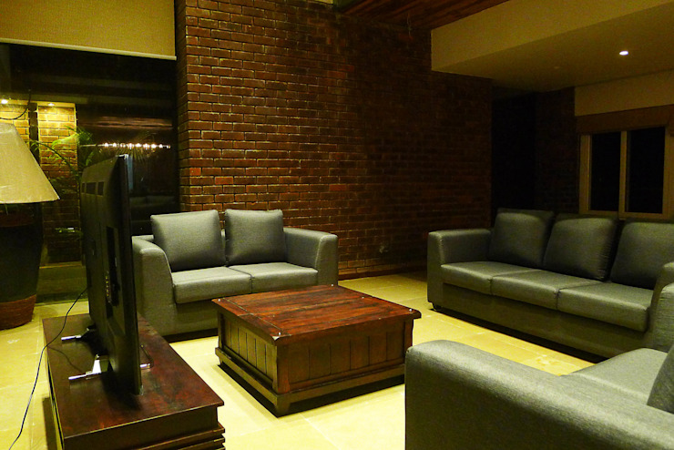 Formal Living space by homify Rustic Bricks