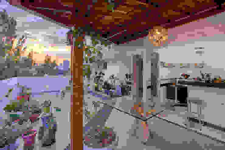 Área Gourmet Varandas, alpendres e terraços modernos por Mágda Braga Interiores Moderno