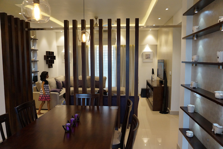 FLAT PURVANKARA.COCHIN.KERALA Modern dining room by INOUTSPACE Modern Solid Wood Multicolored