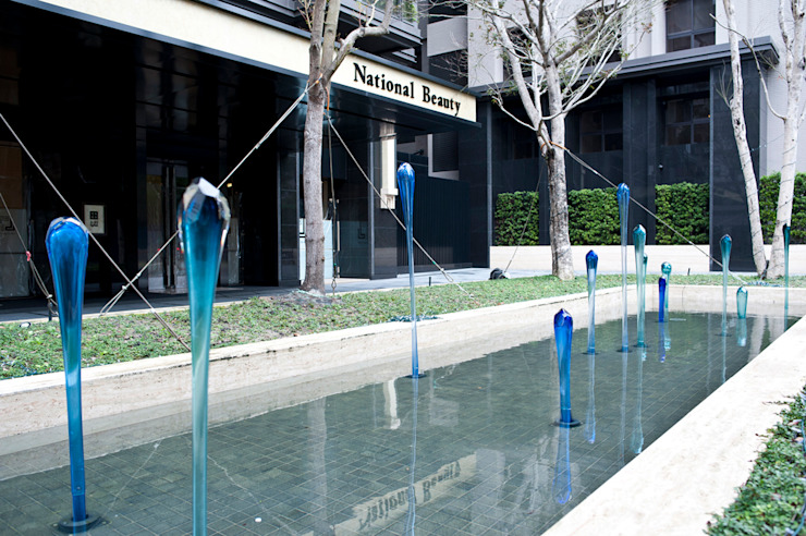 Sporez Espacios comerciales de estilo moderno de Studio Orfeo Quagliata Moderno Vidrio