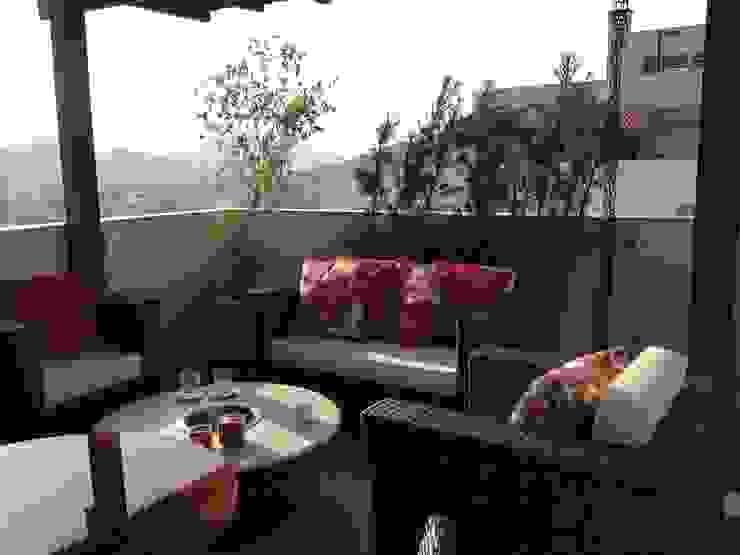 Estar Varandas, alpendres e terraços tropicais por Studio HG Arquitetura Tropical