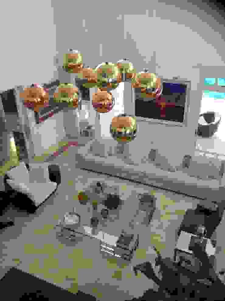 Residência Itaúna Salas de estar ecléticas por Studio HG Arquitetura Eclético