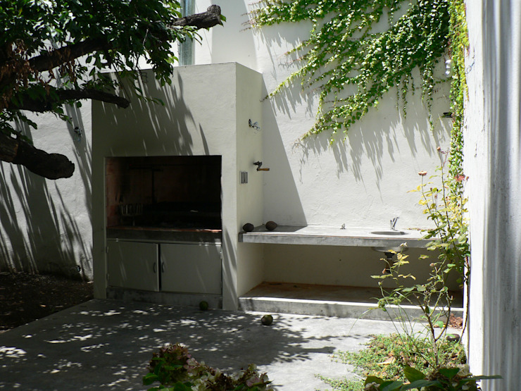 Casa Jufré | Ampliación + Remodelación.: Jardines de estilo  por Paula Mariasch - Juana Grichener - Iris Grosserohde Arquitectura,Moderno