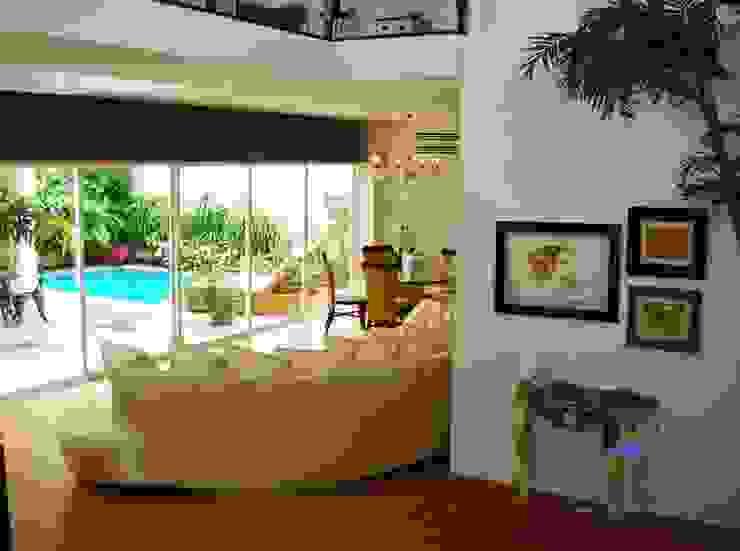 proyecto residencial <q>SR01</q> Salones eclécticos de PORTO Arquitectura + Diseño de Interiores Ecléctico