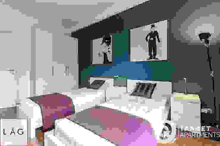 CASA LR Camera da letto moderna di Architrek Moderno
