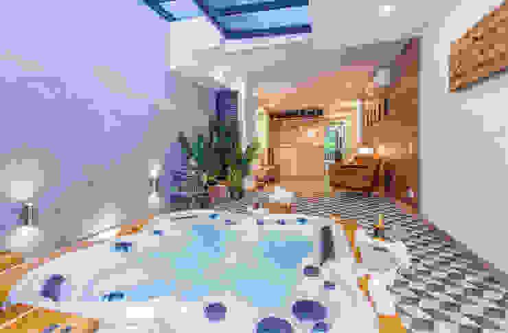 interior zona húmeda apto 102: Hoteles de estilo  por PLANTA BAJA ESTUDIO DE ARQUITECTURA,