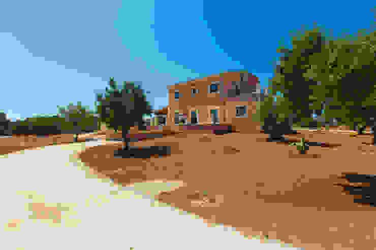 Casas rústicas por ISLABAU constructora Rústico